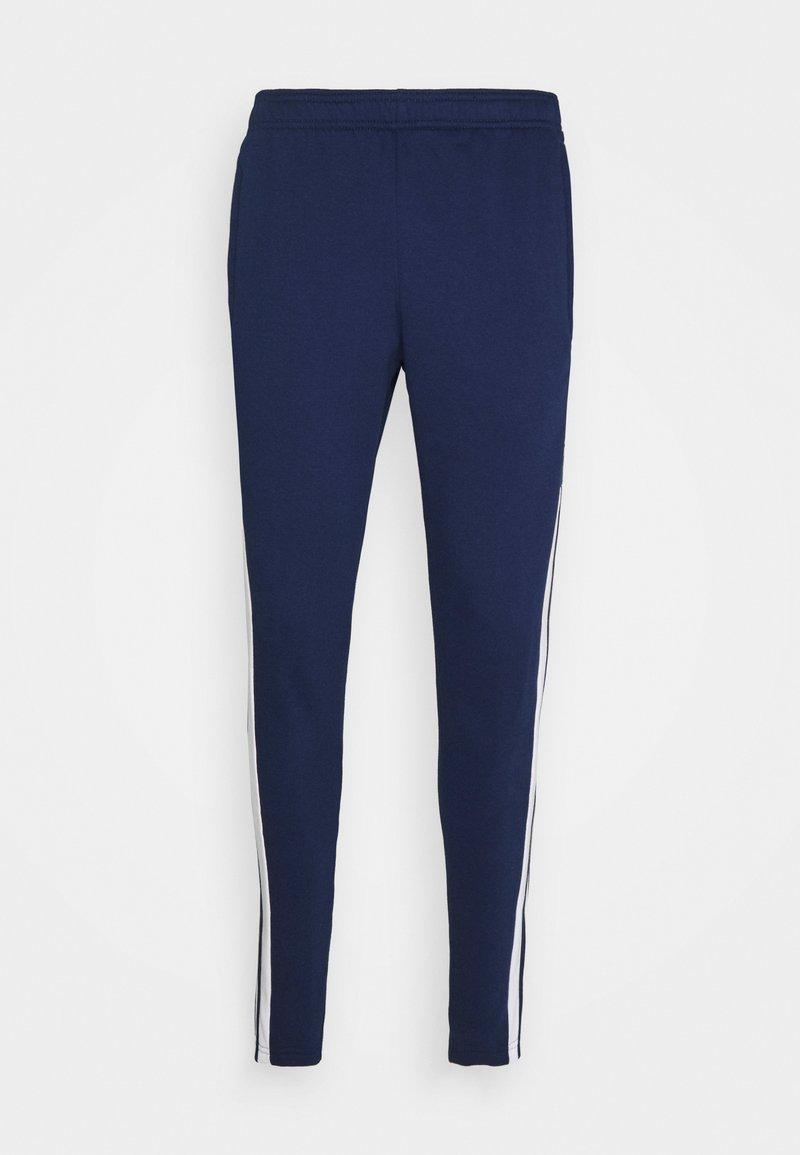 adidas Performance - SQUAD - Tracksuit bottoms - team navy blue