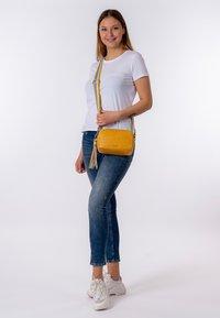 Tamaris - CHRISTA - Across body bag - yellow - 1