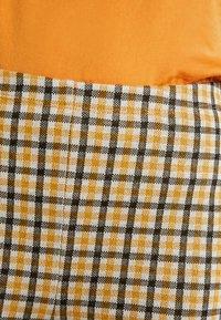 Vila - VIDIGAN FLARE PANT - Trousers - golden rod - 4