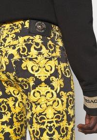 Versace Jeans Couture - TUPO - Slim fit jeans - black - 5
