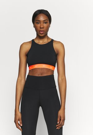 BEYOND THE SWEAT CROP - Medium support sports bra - black