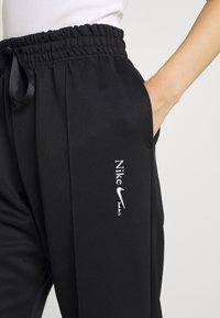 Nike Sportswear - TREND PANT - Tracksuit bottoms - black - 3