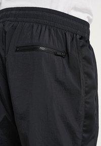 Jordan - FLIGHT WARM UP PANT - Tracksuit bottoms - black - 3