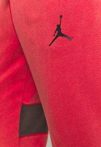 Jordan - AIR PANT - Tracksuit bottoms - gym red/black - 5