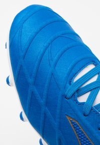 Joma - XPANDER - Moulded stud football boots - blue - 5