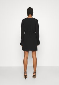 NA-KD - STRAP TIE MINI DRESS - Day dress - black - 2