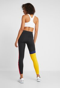 Nike Performance - ONE - Tights - black/university gold/white - 2