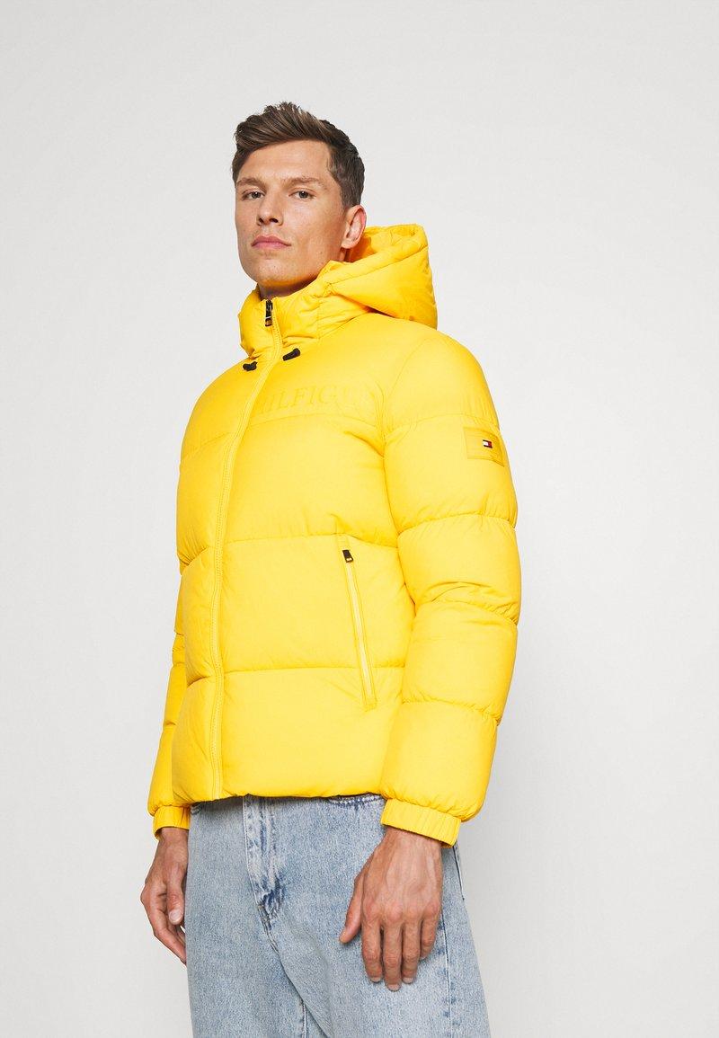 Tommy Hilfiger - HIGH JACKET - Winter jacket - amber glow