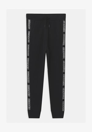 LOGO TAPE - Tracksuit bottoms - black