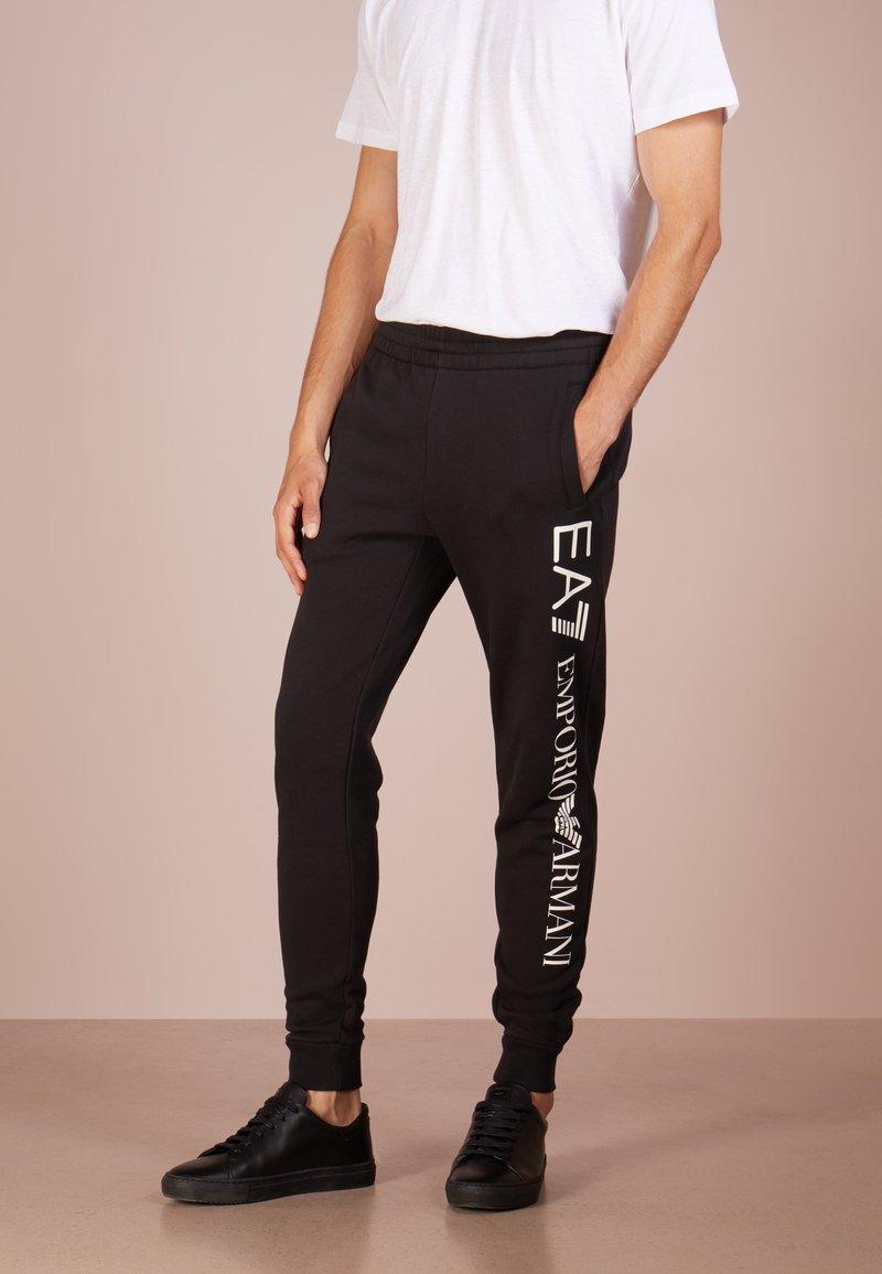 EA7 Emporio Armani - PANTALONI - Tracksuit bottoms - black