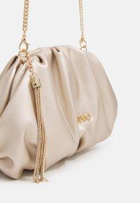 LIU JO - POCHETTE - Across body bag - light gold - 3
