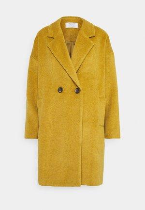 HOGART - Classic coat - yellow
