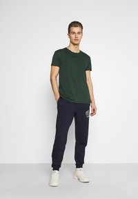 Lacoste - Tracksuit bottoms - navy blue - 1