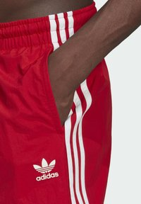 adidas Originals - ADICOLOR CLASSICS 3-STRIPES SWIM SHORTS - Swimming shorts - red - 3
