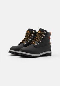 Timberland - PREMIUM UNISEX - Šněrovací kotníkové boty - black - 1