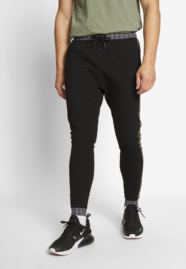 MONOGRAM JOGGERS  - Tracksuit bottoms - black