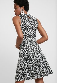 Dorothy Perkins - HIGH NECK BURNOUT FLORAL FIT FLARE - Jersey dress - black
