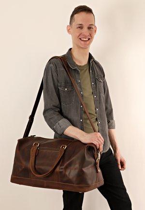 RUBEN - Weekend bag - camel