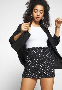 Topshop - FRILL PAPERBAG SHORTS - Shorts - white/black - 3