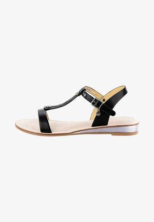 BANNE - Wedge sandals - black
