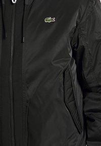 Lacoste Sport - PREMIUMI JACKET - Winter jacket - black - 4
