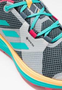 adidas Performance - TERREX TWO GORE-TEX - Zapatillas de trail running - blue/solar gold - 5
