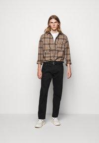 Han Kjøbenhavn - Relaxed fit jeans - black - 0