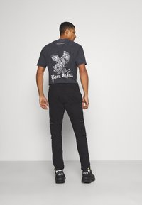 Night Addict - NAASTRID - Cargo trousers - black - 2