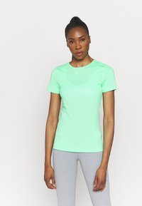 Nike Performance - ALL OVER - T-shirt - bas - green glow/white - 0