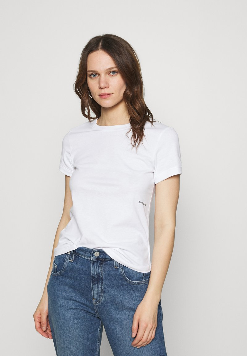 Calvin Klein Jeans - MICRO BRANDING OFF PLACED TEE - T-shirts - bright white