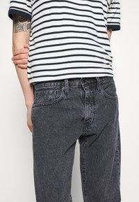 Levi's® - WELLTHREAD 502™ - Straight leg jeans - black denim - 3