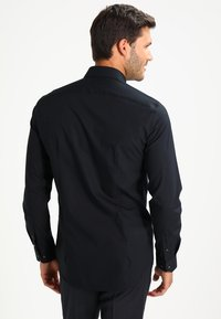 Tommy Hilfiger Tailored - SLIM FIT - Formal shirt - black - 2