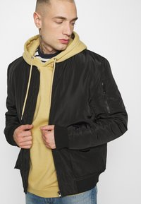 Common Kollectiv - JACKET UNISEX  - Bomber Jacket - black - 3