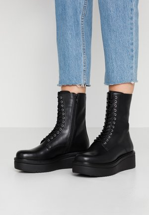 TARA - Platform ankle boots - black