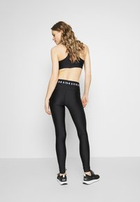 Under Armour - LEGGING BRANDED - Collants - black/white/metallic silver - 2