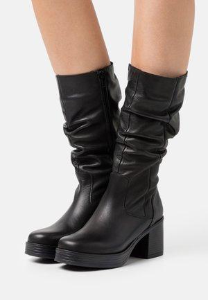 NAIRA - Platform boots - black