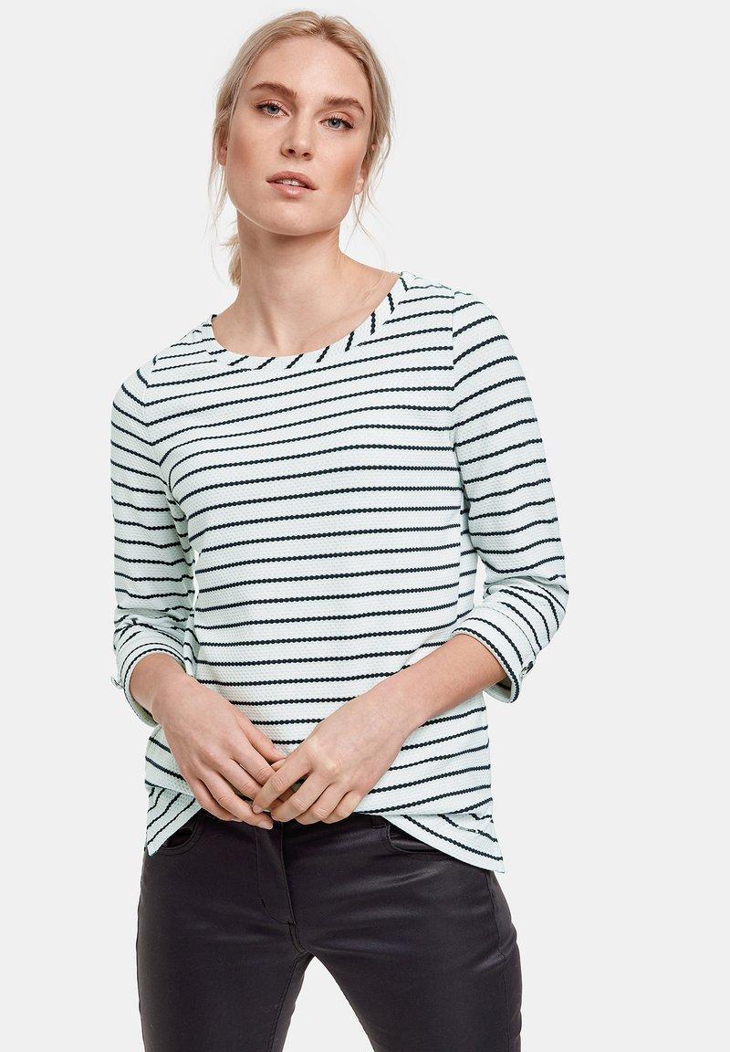 Taifun - Long sleeved top - off-white /black ringel