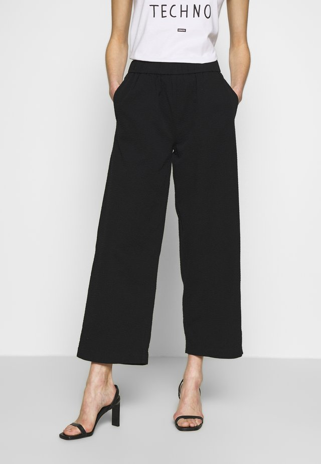 NIA - Trousers - black