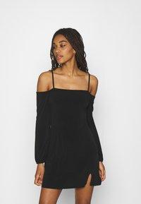 NA-KD - PAMELA REIF OFF SHOULDER MINI DRESS - Jersey dress - black - 0
