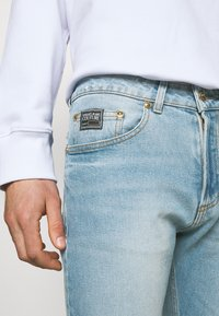 Versace Jeans Couture - AMETIST - Slim fit jeans - light blue denim - 4
