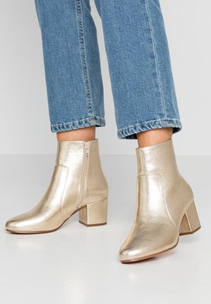 Bottines - gold