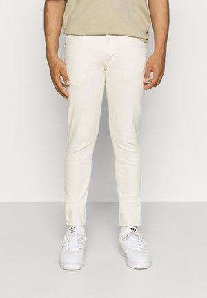 COPENHAGEN - Trousers - pristine