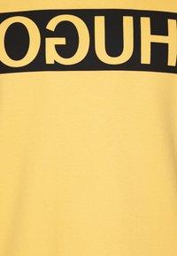 HUGO - DICAGO - Mikina - light/pastel yellow - 2