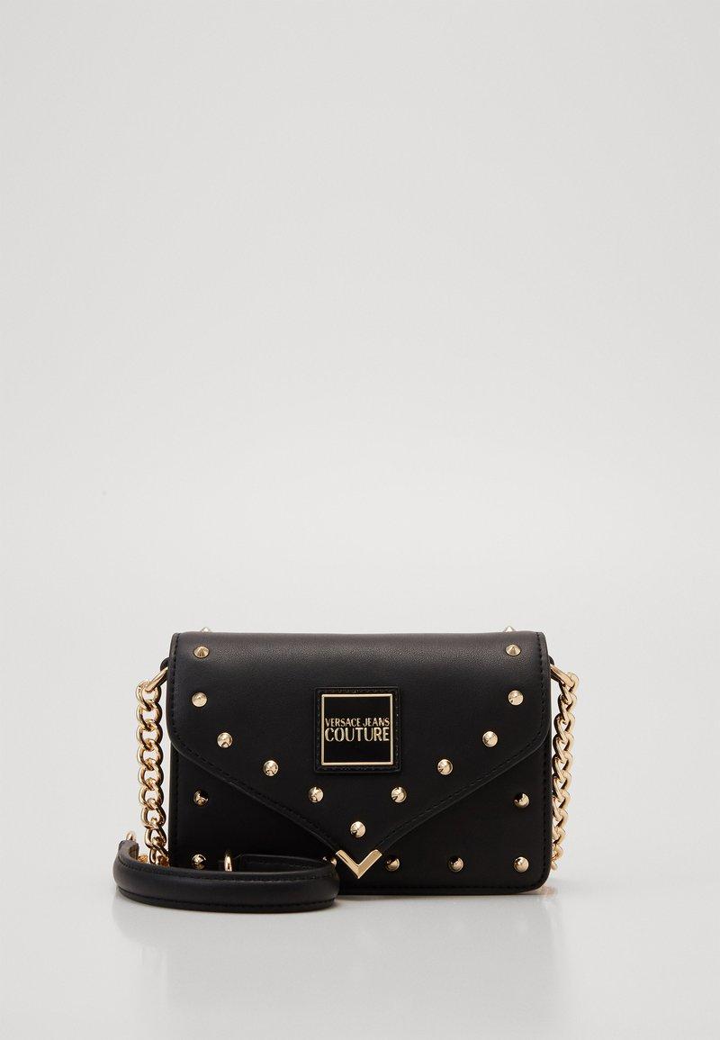 Versace Jeans Couture - MINI CROSSBODY STUDDED - Across body bag - nero/oro