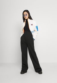 KENDALL + KYLIE - K AND K FLARE HIGH RISE - Pantalones deportivos - black - 1