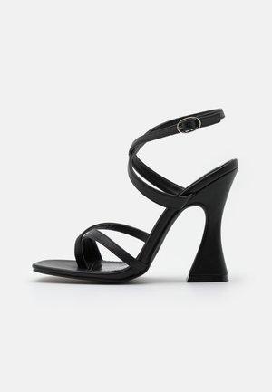 JONAS - Sandaalit nilkkaremmillä - black