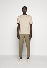 Filippa K - TERRY CROPPED PANTS - Trousers - grey taupe - 1