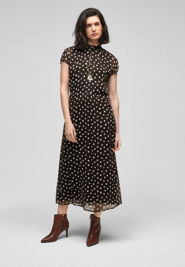 Korte jurk - black polkadots