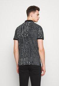 Just Cavalli - ANIMAL PRINT - Polo shirt - black - 2