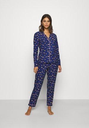 LEOPARD PJ IN A BAG - Pyjamas - blue mix